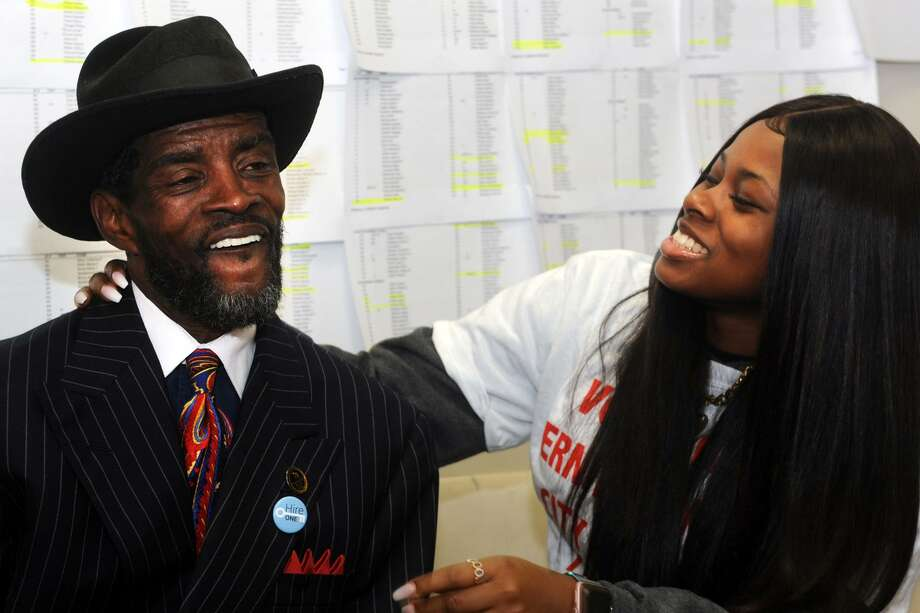 Ernest Newton, candidate in Bridgeport's 139th City Council District, celebrates with his daughter, Kayla, as election results come in at his campaign headquarters in Bridgeport, Conn. Nov. 7, 2017. Newton secured a seat on the city council in Tuesdays elections. Photo: Ned Gerard / Hearst Connecticut Media / Connecticut Post