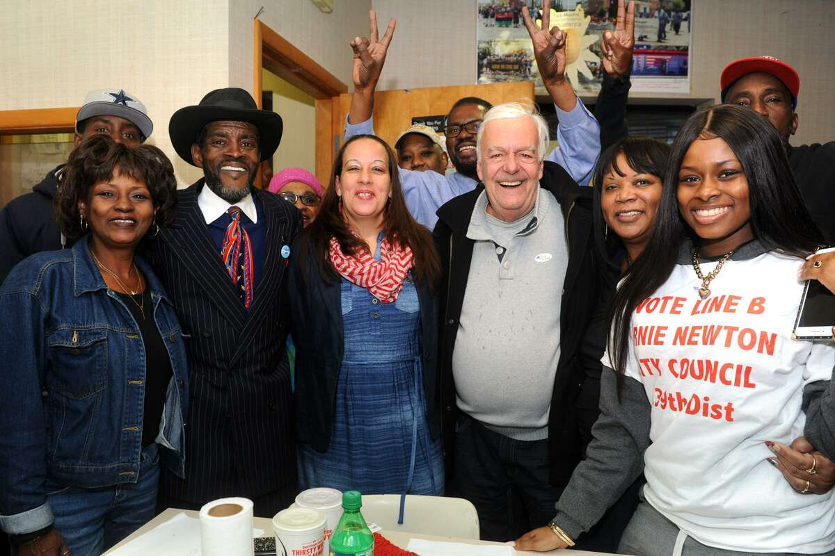 Ernest Newton, candidate in Bridgeport's 139 th City Council District, celebrates with supporters at his campaign headquarters in Bridgeport, Conn. Nov. 7, 2017. Newton secured a seat on the city council in Tuesday's elections. Newton is seen here with his wife Pamela, left, councilwoman Eneida Martinez, third from left, Charlie Coviello, third from right, and Newton's daughter Kayla, far right.