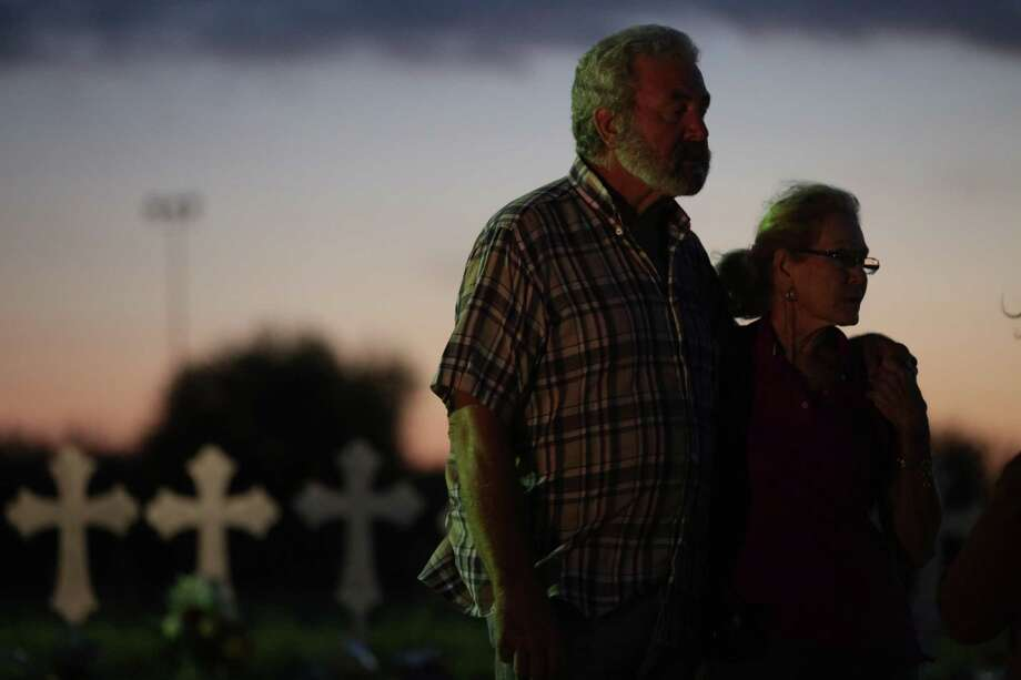 Rod and Judy Green, residents of Sutherland Springs and members of First Baptist Church, visited and placed flowers and flags at the 26 crosses, Texas, on Tuesday, Nov. 7, 2017. Photo: Bob Owen, Staff / San Antonio Express-News / San Antonio Express-News