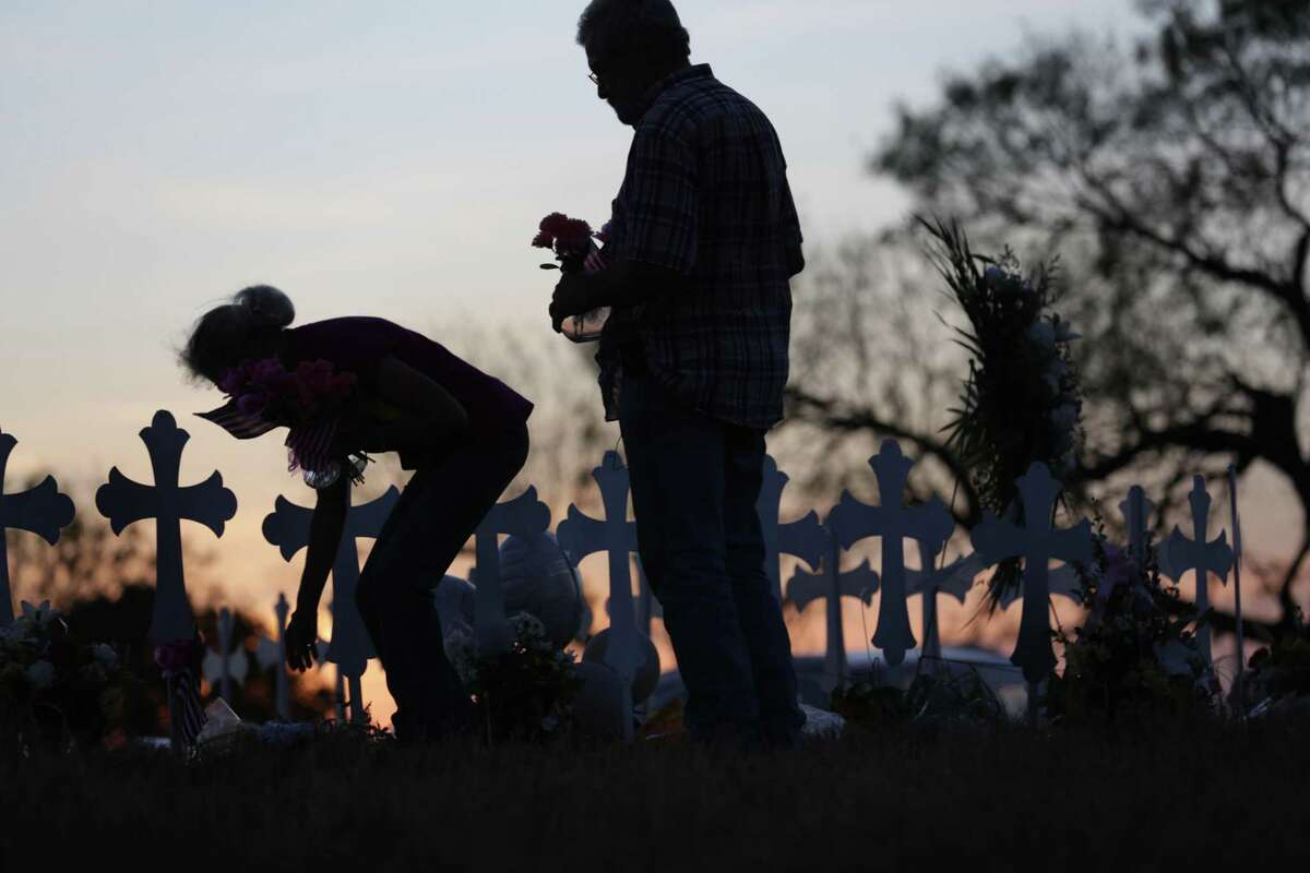 Rod and Judy Green, residents of Sutherland Springs and members of First Baptist Church, visited and placed flowers and flags at the 26 crosses, Texas, on Tuesday, Nov. 7, 2017.