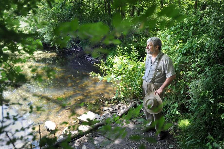 Victor DeMasi, of Redding, stands at the edge of Miller's Pond.  DeMasi is one of the early architects of the Route 7 greenway. Photo taken Friday, June 18, 2010. Photo: Carol Kaliff / The News-Times