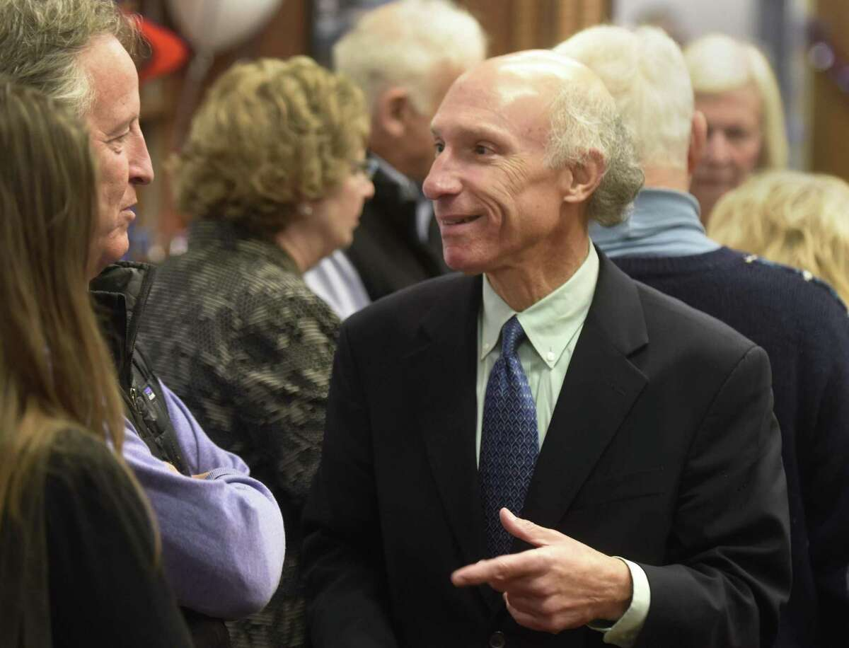 Democratic tax collector candidate Howard Richman chats at the Greenwich Democrats Election Night Party at the Senior Center in Greenwich, Conn. Tuesday, Nov. 7, 2017. Democrat Howard Richman ran against incumbent Republican Tod Laudonia for the position of tax collector.