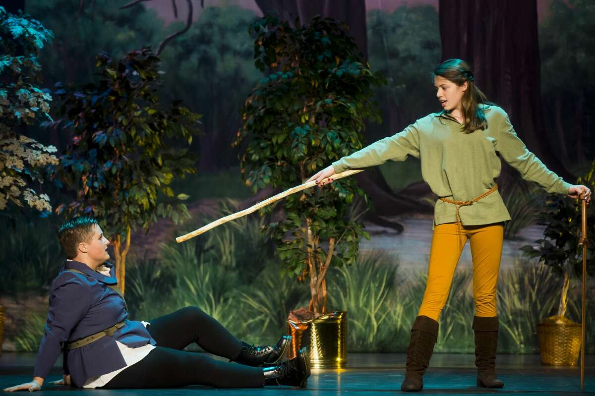 Sophia Hahn, playing the role of Robin Hood, right, and Faith Jacobs, playing the role of Sheriff Tomas Allard, act out a scene during a dress rehearsal on Monday, Nov. 6, 2017 for Bullock Creek High School's production of Robin Hood at Bullock Creek High School. (Katy Kildee/kkildee@mdn.net)