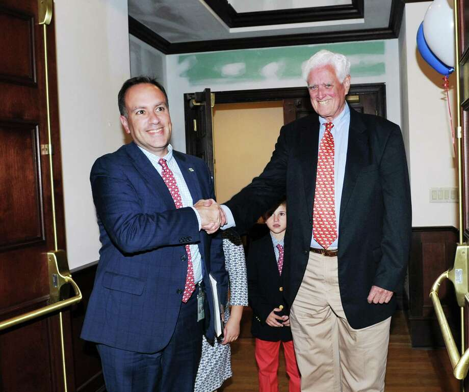 Greenwich First Selectman Peter Tesei, a Republican, left, with Selectman John Toner, also a Republican, shook hands as they celebrated their election night victory at the Milbrook Club in Greenwich, Conn., Tuesday night, Nov. 7, 2017. Photo: Bob Luckey Jr. / Hearst Connecticut Media / Greenwich Time