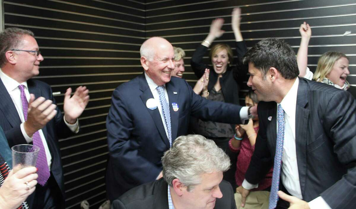 First Selectman Jim Marpe, center, celebrates winning re-election at the Republican Town Committee headquarters at 170 Post Road West.