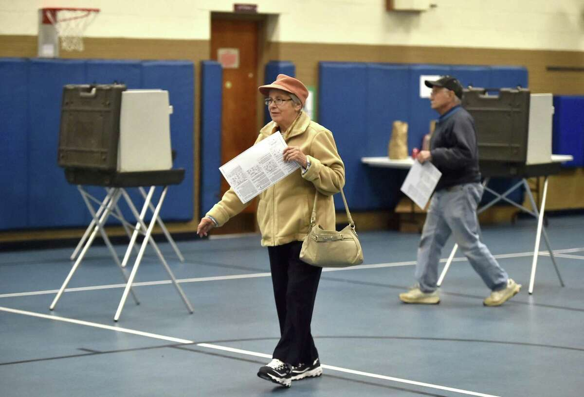 Rose Bruno of East Haven prepares to cast her vote Tuesday at the Overbrook School in East Haven.
