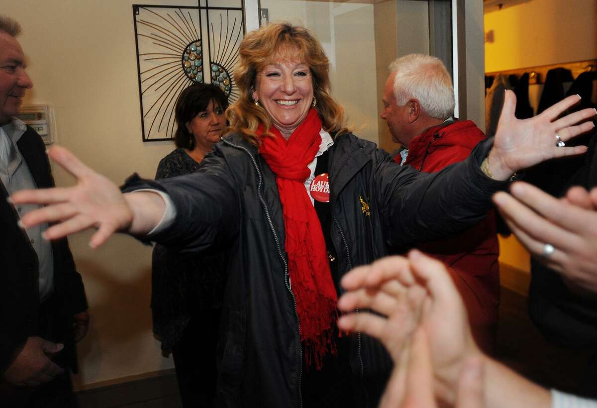 Newly-elected Stratford Mayor Laura Hoydick is ready to hug supporters as she enters her victory party at the Riverview Bistro restaurant in Stratford on Tuesday night.