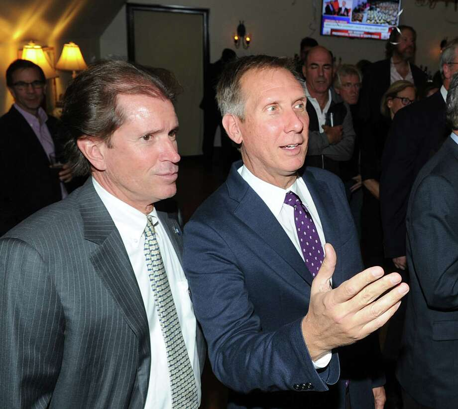 Board of Education Chairman Peter Sherr, a Republican, right, celebrates his election night victory with State Senator Scott Frantz, left, at the Milbrook Club in Greenwich, Conn., Tuesday night, Nov. 7, 2017. Photo: Bob Luckey Jr., Hearst Connecticut Media / Greenwich Time