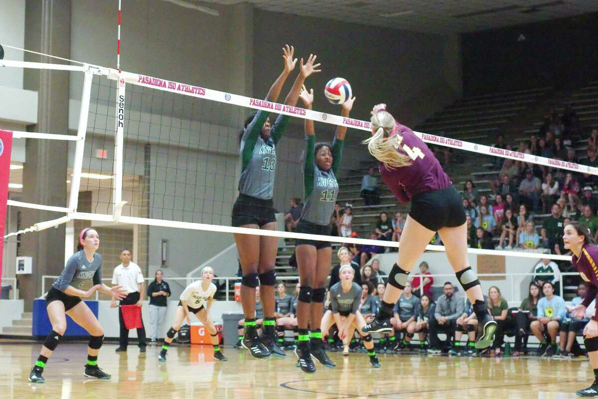 Clear Falls' Anita Parrott (13) and Clear Falls' Rachel Brown (11) go high to block a shot by Deer Park's Morgan Railey (4) Tuesday, Nov. 7 at Pasadena ISD Phillips Field House.