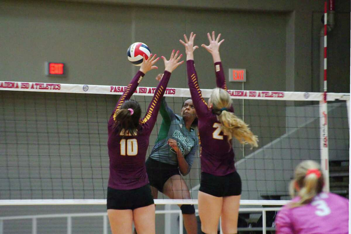 Clear Falls' Anita Parrott (13) tries to hit a shot past Deer Park's Emma Aillet (10) and Deer Park's Hope Hawthorne (24) Tuesday, Nov. 7 at Pasadena ISD Phillips Field House.