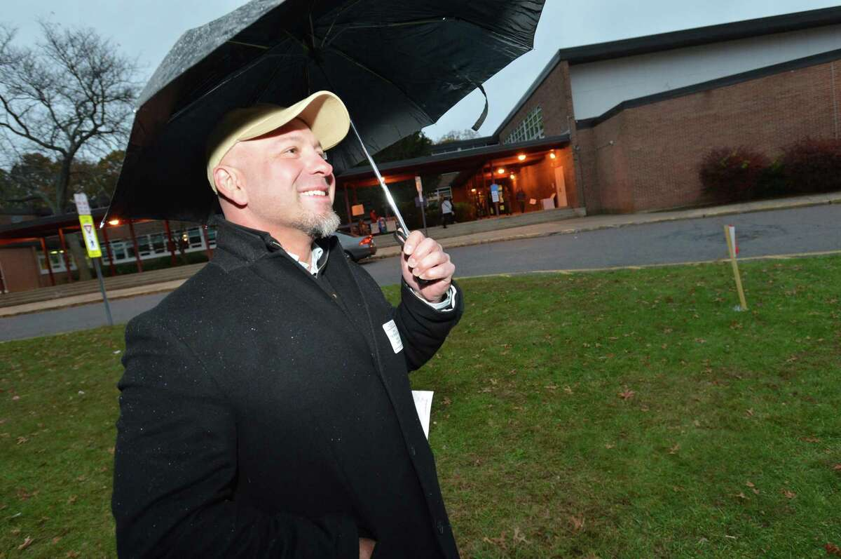 Candidate for District D Councilman George Tsiranides campaigns during voting on election day at Ponus Ridge Middle School on Tuesday November 7, 2017 in Norwalk Conn