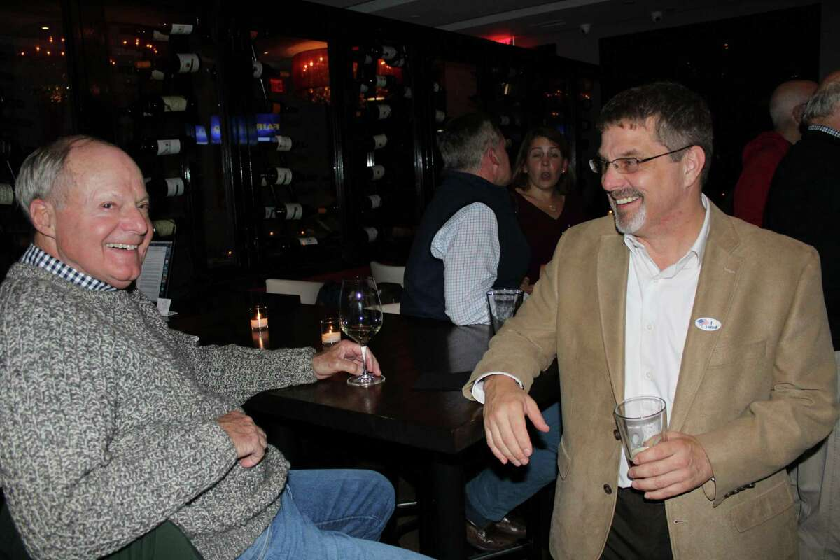 Petition candidate and former Republican Town Committee chairman Al Alper awaits election results with a fellow Wilton Republican on Tuesday, Nov. 7.