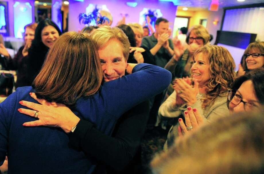 Vicki Tesoro hugs a supporter after winning election as Trumbull's first selectman during a gathering at Tashua Knolls Golf Club in Trumbull on Tuesday. Photo: Christian Abraham / Hearst Connecticut Media / Connecticut Post