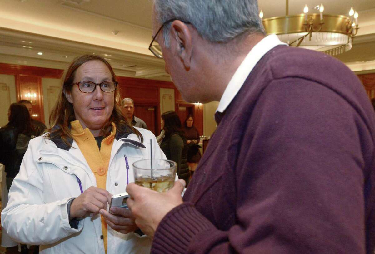 Candidate for councilman Ellen Wink chats with a supporter Tony Coppola at the Norwalk Inn & Conference Center Tuesday, Nov. 8, in Norwalk.