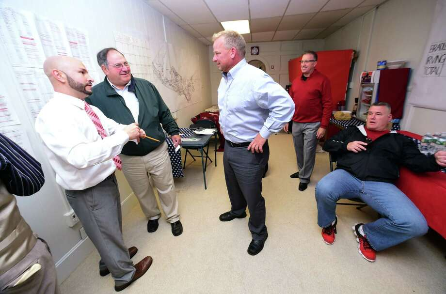 Left to right, campaign manager Andrew Baklik and Dave Kopjanski talk with Republican Derby mayoral candidate Rich Dziekan at campaign headquarters on November 7, 2017. Photo: Arnold Gold, Hearst Connecticut Media / New Haven Register