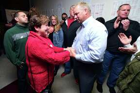 Derby Mayor Anita Dugatto, left, congratulates Rich Dziekan on his victory in the mayoral contest at his headquarters on Tuesday night.