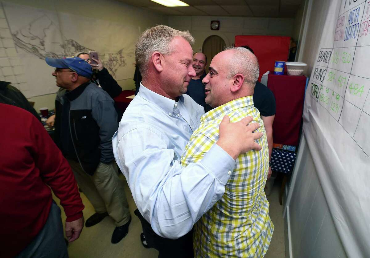 Rich Dziekan (left) hugs Derby Republican Town Committee Chairman Sam Pollastro as results come in at campaign headquarters in Derby on November 7, 2017.