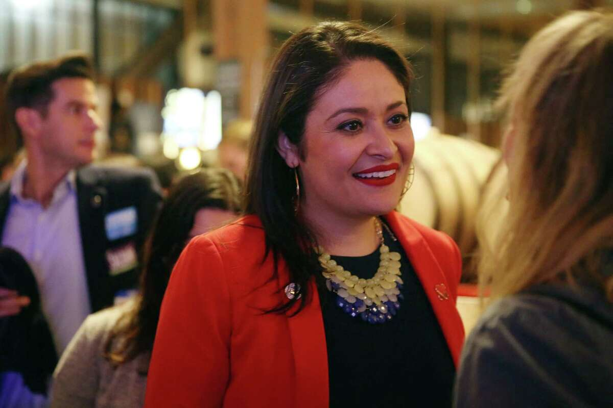 Seattle City Council Position 9 incumbent Lorena González talks with supporters on election night, Tuesday, Nov. 7, 2017, at Optimism Brewing.