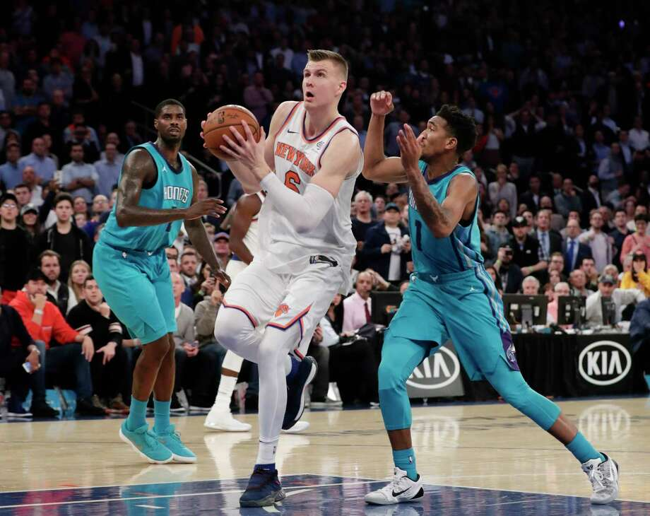 New York Knicks' Kristaps Porzingis (6) drives past Charlotte Hornets' Malik Monk (1) to score during the second half of an NBA basketball game Tuesday, Nov. 7, 2017, in New York. The Knicks won 118-113. (AP Photo/Frank Franklin II) ORG XMIT: MSG111 Photo: Frank Franklin II / Copyright 2017 The Associated Press. All rights reserved.