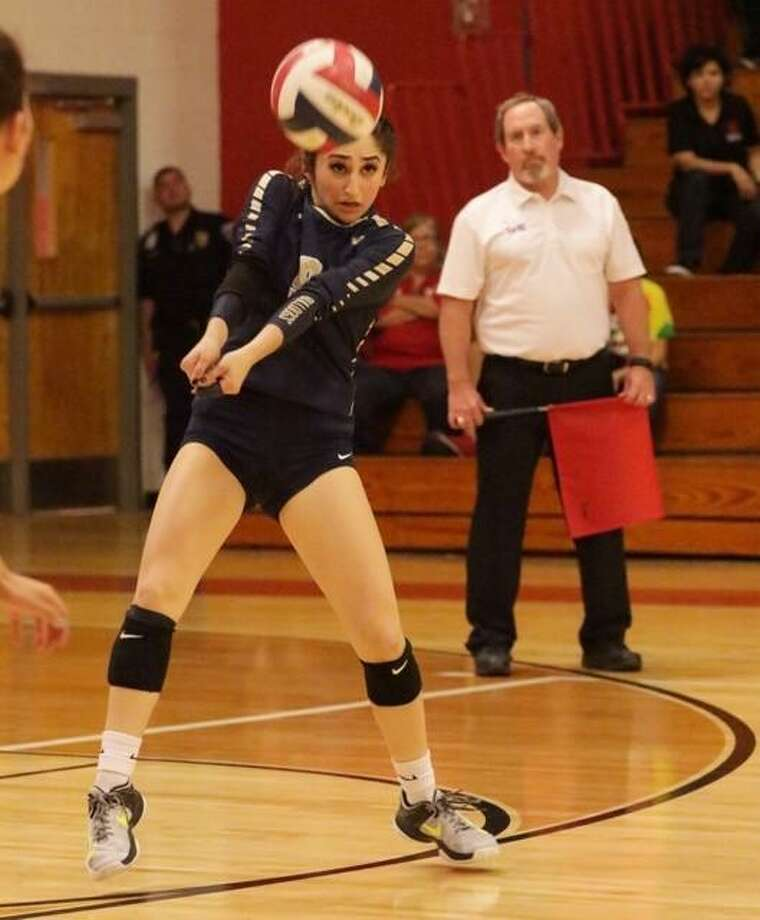 Senior Anissa Davila had 16 digs as Alexander lost for the second straight year in the regional quarterfinals to McAllen Memorial falling in straight sets Tuesday night. Photo: Clara Sandoval / Laredo Morning Times
