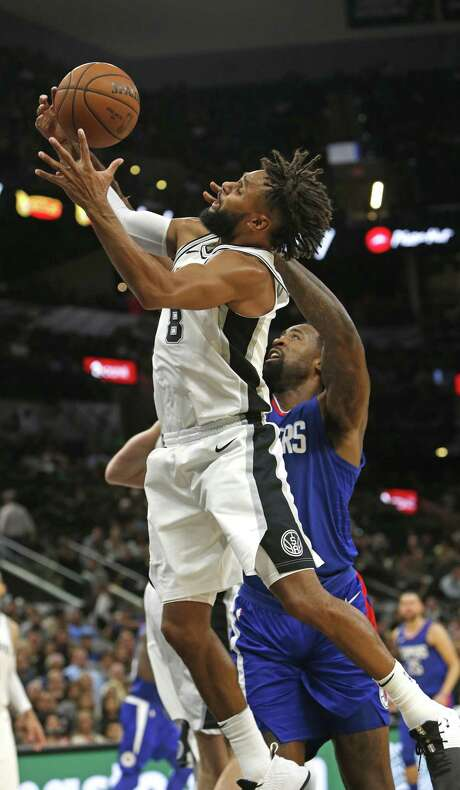 Patty Mills #8 of the San Antonio Spurs out rebounds DeAndre Jordan #6 of the Los Angeles Clippers from Spurs-Clippers game on Monday November 6, 2017. Photo: Ron Cortes, Freelance / For The San Antonio Express-News