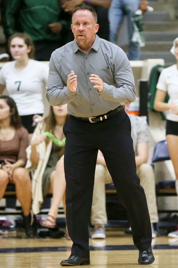 Reagan coach Mike Carter on the sideline during their Class 6A third-round high school volleyball playoff match with Clark at the Alamo Convocation Center on Tuesday, Nov. 7, 2017.  MARVIN PFEIFFER/mpfeiffer@express-news.net Photo: Marvin Pfeiffer, Staff / San Antonio Express-News / Express-News 2017