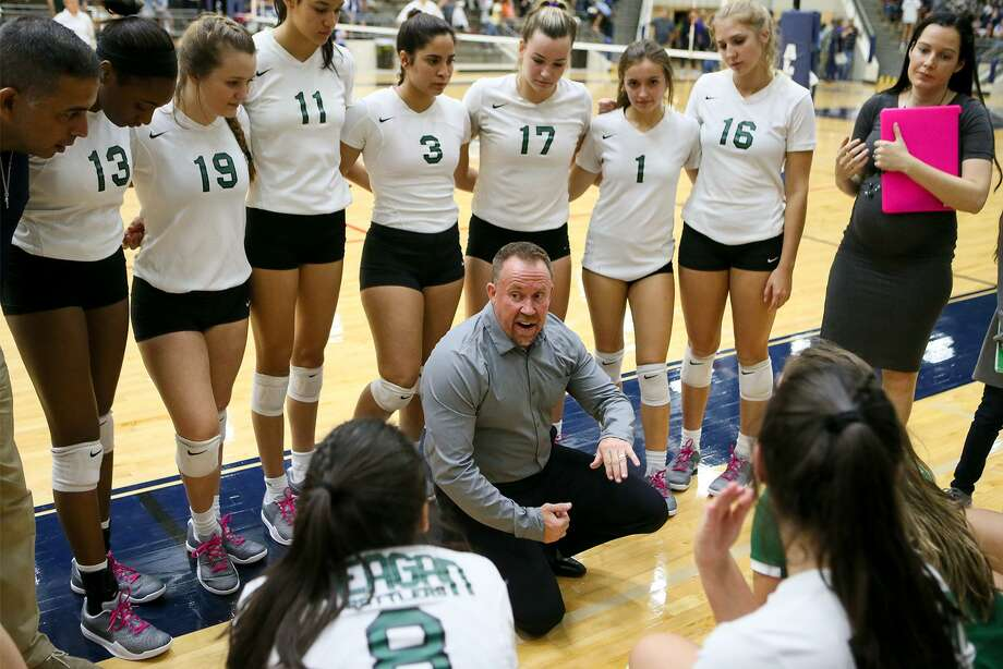 Reagan coach Mike Carter talks to his team during a time out in their Class 6A third-round high school volleyball playoff match with Clark at the Alamo Convocation Center on Tuesday, Nov. 7, 2017.  MARVIN PFEIFFER/mpfeiffer@express-news.net Photo: Marvin Pfeiffer, Staff / San Antonio Express-News / Express-News 2017