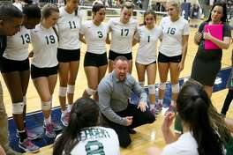 Reagan coach Mike Carter talks to his team during a time out in their Class 6A third-round high school volleyball playoff match with Clark at the Alamo Convocation Center on Tuesday, Nov. 7, 2017.  MARVIN PFEIFFER/mpfeiffer@express-news.net