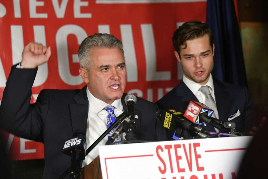 Assemblyman Steven McLaughlin declares victory with a speech at O'Brien's Public House on Tuesday Nov. 7, 2017 in Troy, N.Y. McLaughlin ran against Andrea Smyth for Rensselaer country executive. His son Sean McLaughlin stands next to him at right. (Lori Van Buren / Times Union) Photo: Lori Van Buren / 0042060A