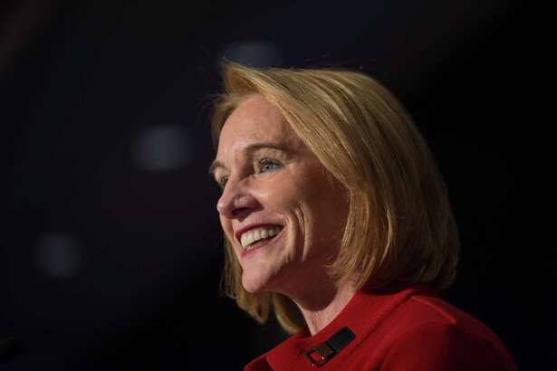 Mayoral candidate Jenny Durkan smiles at the crowd as she takes the stage following the initial vote tally giving her a strong lead over opponent Cary Moon, at the Westin Hotel on election night, Tuesday, Nov. 7, 2017.