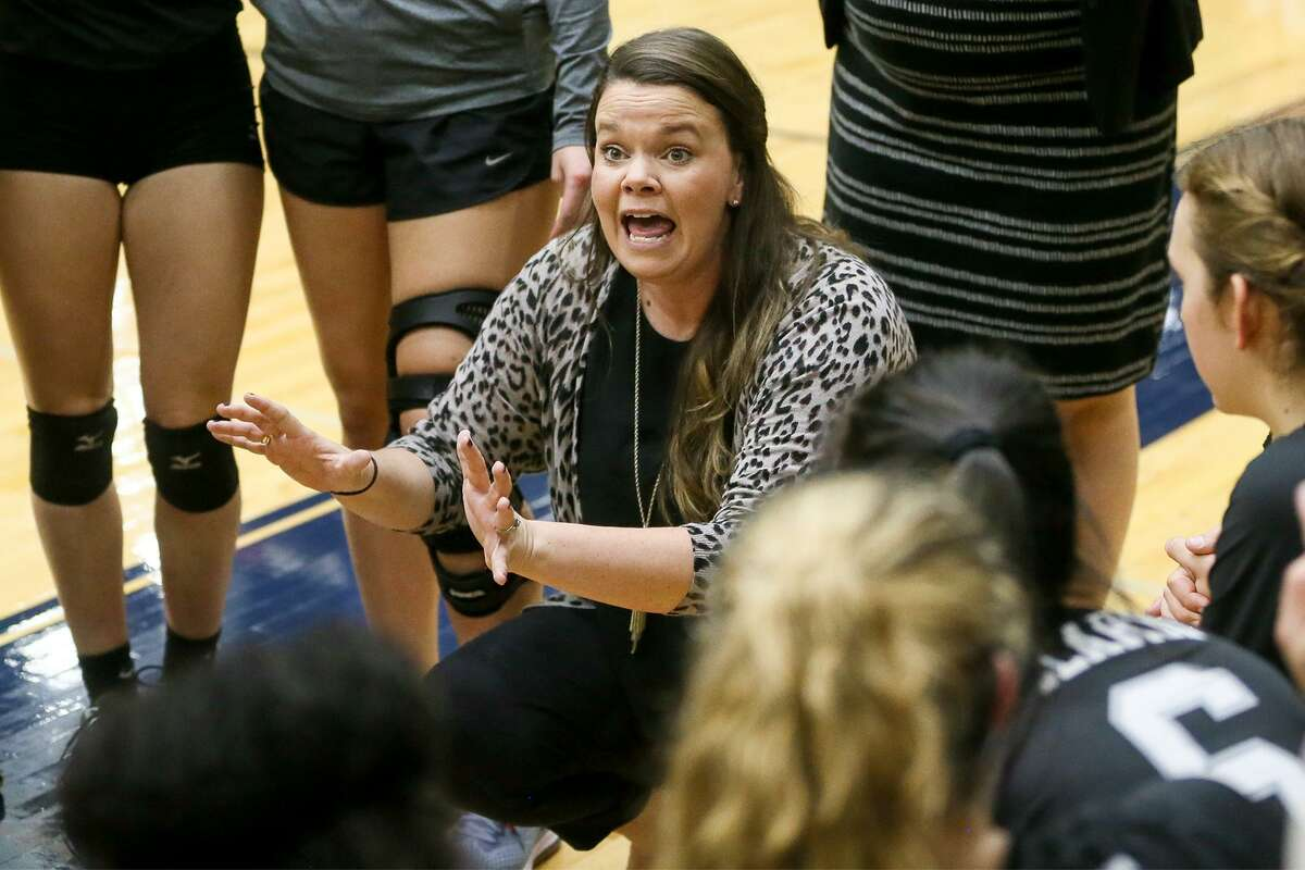 Clark head coach Melissa Miller talks to her team during a time out in their Class 6A third-round high school volleyball playoff match with Reagan at the Alamo Convocation Center on Tuesday, Nov. 7, 2017. MARVIN PFEIFFER/mpfeiffer@express-news.net