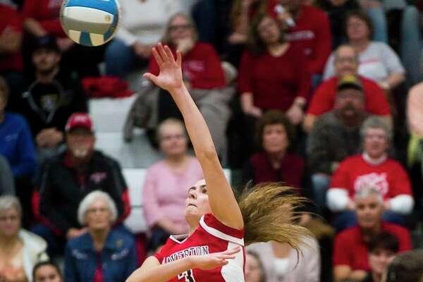 Beaverton senior Reiss Faber spikes the ball Tuesday at Pinconning High School. (Katy Kildee/kkildee@mdn.net)