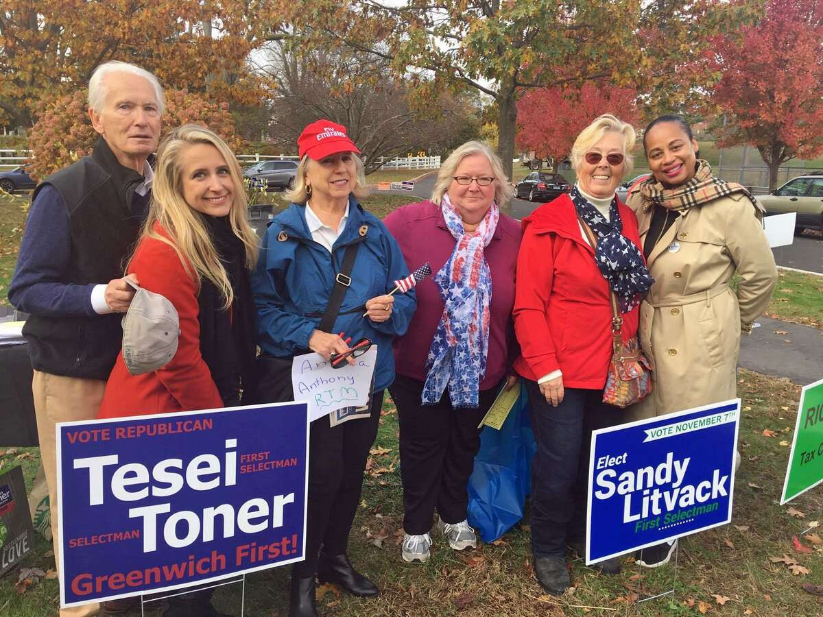 District 1 RTM candidates from left: Robert Robins, Jessica Delguercio, Andrea Edwards Anthony, Judith Gross, Helma Varga and Elizabeth Sanders Mills greet voters outside Julian Curtiss School on Tuesday.