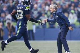 Seahawks head coach Pete Carroll greets Dwight Freeney during the third quarter of a game against Houston at CenturyLink Field on Oct. 29, 2017.