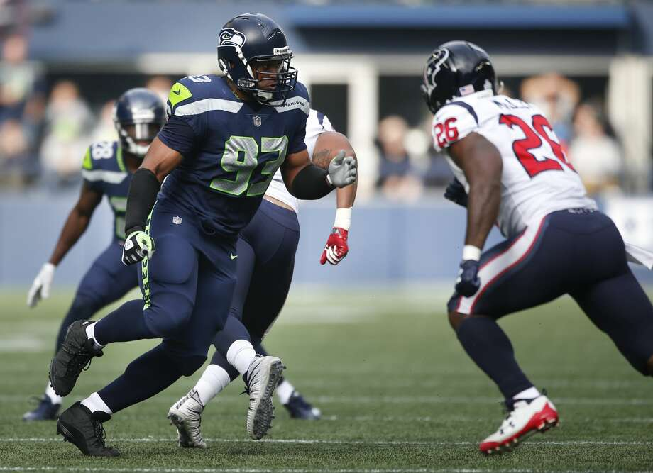 SEATTLE, WA - OCTOBER 29: Defensive end Dwight Freeney #93 of the Seattle Seahawks looks to block running back Lamar Miller #26 of the Houston Texans during the first half of the game at CenturyLink Field on October 29, 2017 in Seattle, Washington. (Photo by Otto Greule Jr/Getty Images) Photo: Otto Greule Jr/Getty Images