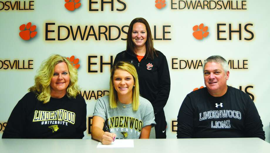 Edwardsville High School senior Addy Zeller, center, sits with her parents Tony, right, and Shelly, left, to announce she will play women's golf at Lindenwood University. EHS girls' golf coach Abby Comerford stands behind them.