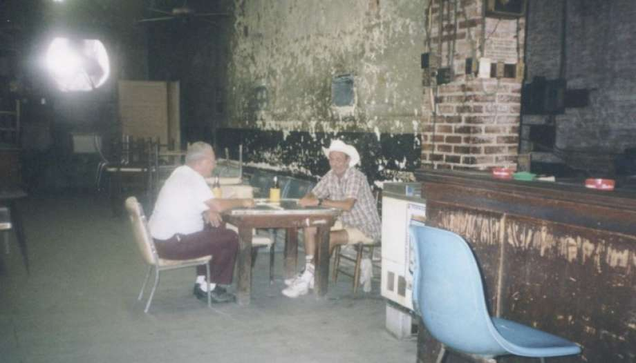 Gentlemen play dominos at Talley's Domino Hall in downtown Conroe in 1999.