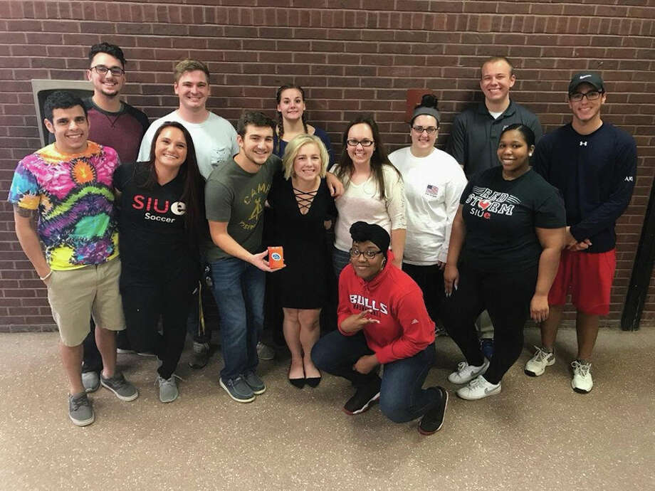 SIUE students involved with 26 are, in back from left: Will Smith, Joey Miles, Carissa Gates, James Moss and Austin Glendinning. In front are from left: Ben Zuccarelli, Mariah Vollmer, Sam Butler, Briana Leifker, Juleah Markham, Allison Buck and Maui Evans. Kneeling is Symone Hill. Not pictured is Danielle Lee.  Photo: For The Intelligencer