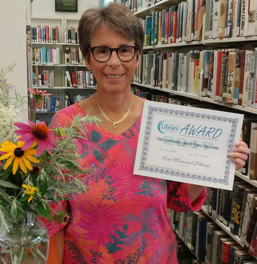Kent Memorial Library's Marketing and Special Events Director Lucy C. Pierpont holds the award won for Outstanding Library Public Relations in Print Media for the invitation and program materials for the 2016 Annual Spring Gala fundraising event in Kent. Photo: Courtesy Of Kent Memorial Library / The News-Times Contributed