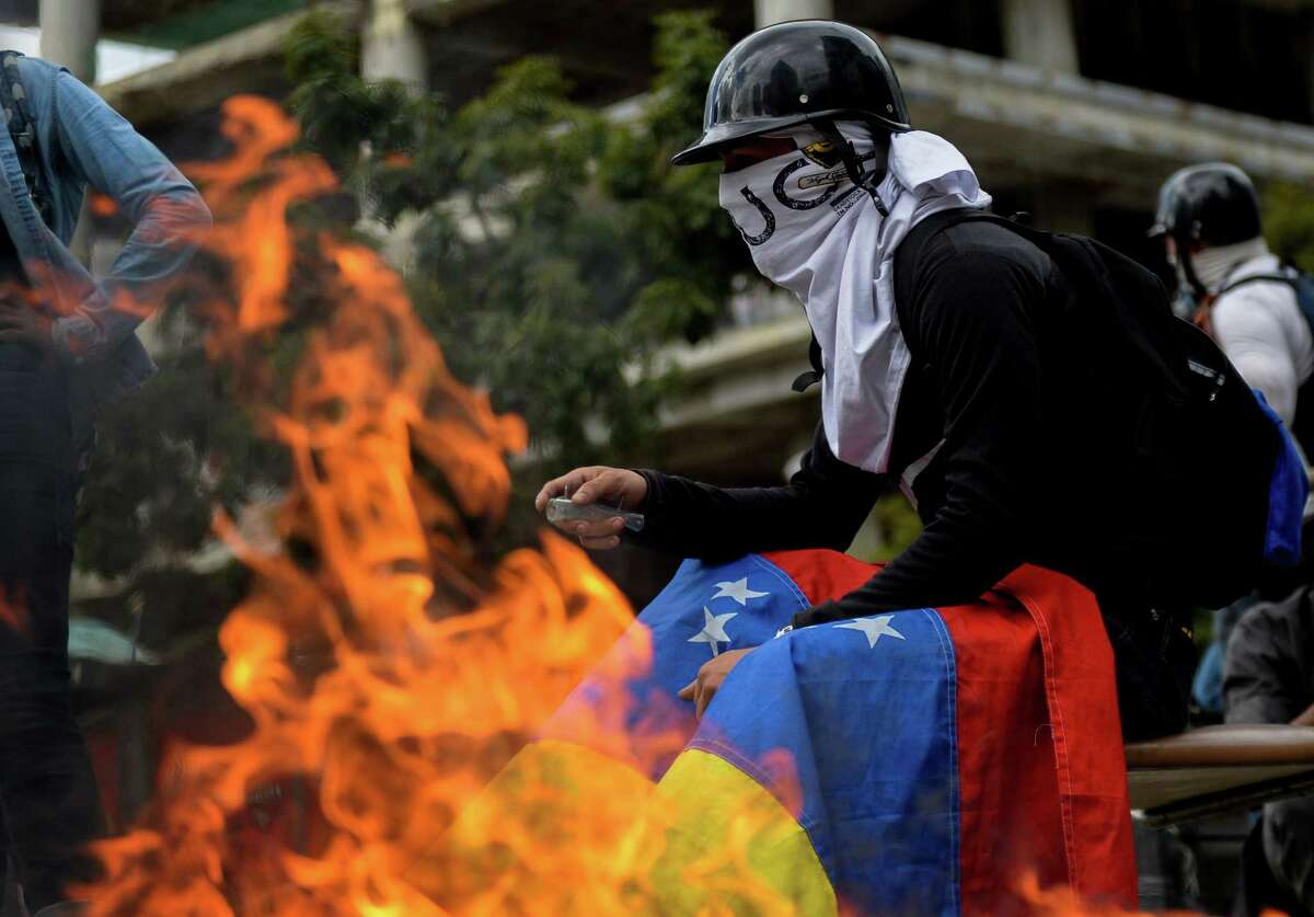 Opposition activists ha protest against the newly inaugurated Constituent Assembly in Caracas on August 4, 2017. Venezuelan President Nicolas Maduro installed a powerful new assembly packed with his allies, dismissing an international outcry and opposition protests saying he is burying democracy in his crisis-hit country. / AFP PHOTO / FEDERICO PARRAFEDERICO PARRA/AFP/Getty Images