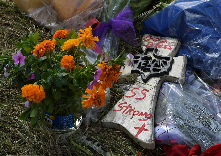 Flowers and other items left at a memorial are seen outside the First Baptist Church, after a mass shooting that killed 26 people in Sutherland Springs, Texas on November 7, 2017. A gunman wearing all black armed with an assault rifle opened fire on a small-town Texas church during Sunday morning services, killing 26 people and wounding 20 more in the last mass shooting to shock the United States. / AFP PHOTO / MARK RALSTON        (Photo credit should read MARK RALSTON/AFP/Getty Images) Photo: MARK RALSTON/AFP/Getty Images