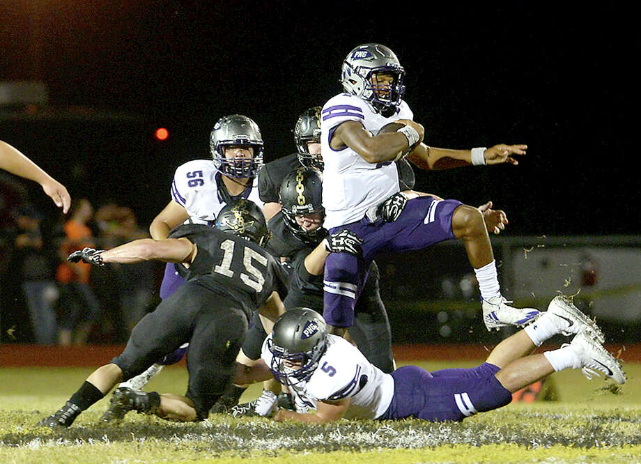 Vidor's defense fails to stop Port Neches - Groves' Roschon Johnson as he leaps over to pick up yardage during their District 22 - 5A match-up Friday night in Vidor. Photo taken Friday, October 20, 2017 Kim Brent/The Enterprise Photo: Kim Brent / BEN