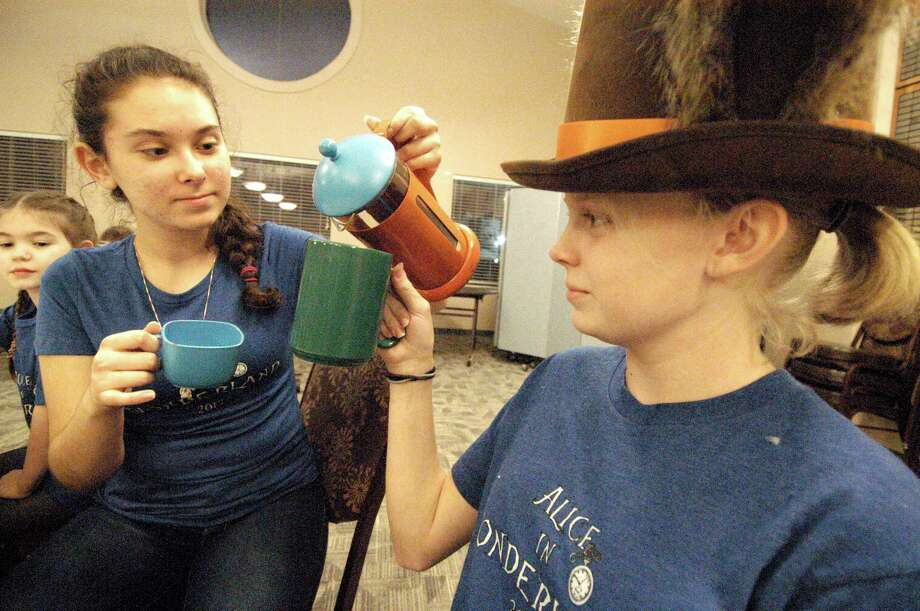 """Nicoleta Savage, 14, and Avonlea Evers, 8, practice lines for  Pearland Little Theatre's production of a msical version of """"Alice in Wonderland,"""" which is being performed Nov. 17-19 at San Jacinto College South."""