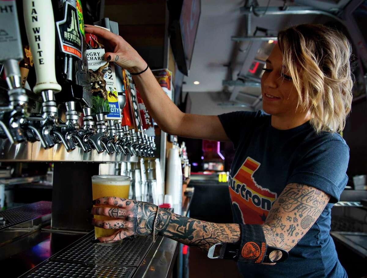 Bartender Chelsea Klinton drafts a beer at The Pub Galleria on Richmond on Saturday, Nov. 4, 2013. (Annie Mulligan / Freelance)
