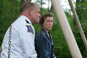 """This image released by Fox Searchlight shows Woody Harrelson, left, and Frances McDormand in a scene from """"Three Billboards Outside Ebbing, Missouri."""" (Fox Searchlight via AP)"""