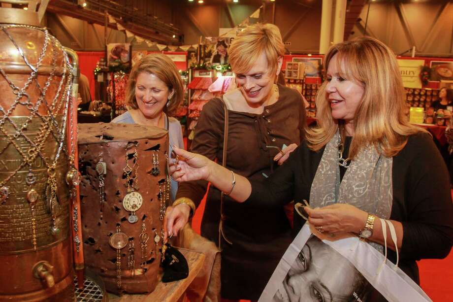 Donna Lively, from left, Diane Frels and Cindy Garza shopping at the annual Nutcracker Market preview party in November.  Photo: Gary Fountain, For The Chronicle / Copyright 2016 Gary Fountain