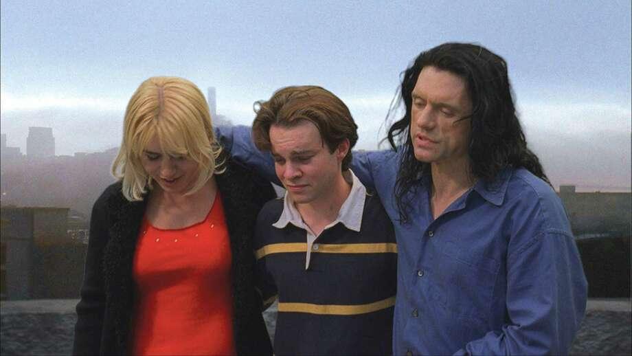 "Juliette Danielle, Philip Haldiman, and Tommy Wiseau in ""The Room."""