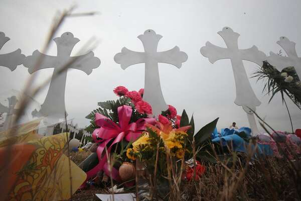 SUTHERLAND SPRINGS, TX - NOVEMBER 08: Twenty-six crosses stand in a field on the edge of town to honor the 26 victims killed at the First Baptist Church of Sutherland Springs on November 8, 2017 in Sutherland Springs, Texas. On November 5, a gunman, Devin Patrick Kelley, shot and killed the 26 people and wounded 20 others when he opened fire during Sunday service at the church. (Photo by Scott Olson/Getty Images)