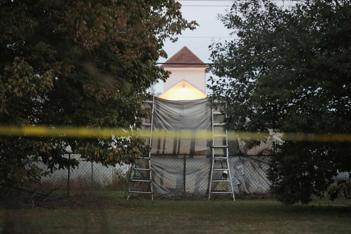 SUTHERLAND SPRINGS, TX - NOVEMBER 08: A tarp hangs in front of the Sutherland Springs Baptist church November 8, 2017 in Sutherland Springs, Texas. The tarp was placed in the yard by a local resident to prevent news media from photographing the church from the street outside of their property. On November 5, a gunman, Devin Patrick Kelley, killed 26 people at the church and wounded 20 others when he opened fire during a Sunday service. (Photo by Scott Olson/Getty Images)