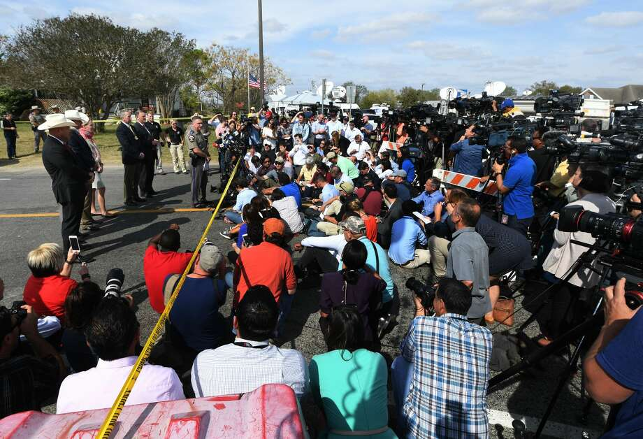 Officials hold a press conference outside the First Baptist Church, after a mass shooting that killed 26 people in Sutherland Springs, Texas on November 7, 2017.  A gunman wearing all black armed with an assault rifle opened fire on a small-town Texas church during Sunday morning services, killing 26 people and wounding 20 more in the last mass shooting to shock the United States. Photo: MARK RALSTON/AFP/Getty Images